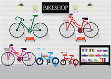 Bicycle stores or bike shops. Bicycle stores or bike shops with many size bicycle hanger on brick wall background and equipment, interior shop vector Stock Photo