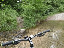 Bicycle and stream Royalty Free Stock Photo