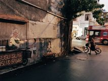 Bicycle on the street of Penang Georgetown Malaysia. Bicycle and street art stock photo