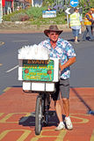 Bicycle street vendor toffee apples Stock Photo
