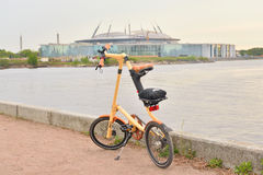 Bicycle Strida On Coast Of River At Sunset. Stock Photography