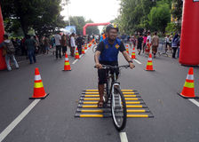 Bicycle stunt riding. Residents are following the race Stunt riding a bicycle on a street in the city of Solo, Central Java, Indonesia Stock Photography