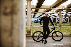 Bicycle style male. In black clothes and sunglasses Stock Photos