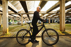 Bicycle style man in black sportswear. And sunglasses in urban street Stock Photography