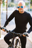 Bicycle style man portrait. In black sportswear Stock Image
