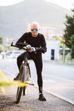 Bicycle style man portrait. In black sportswear Stock Photo