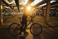 Bicycle style man with sunlight. Bicycle style man in sunglasses with sunlight Stock Image