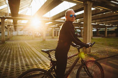 Bicycle style man with sunlight. Bicycle style man in sunglasses with sunlight Royalty Free Stock Photography