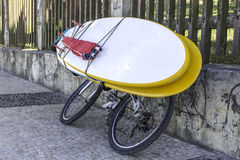 Bicycle with surfing board stock images