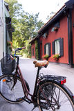 Bicycle in a Swedish village. Bycicle in a typical Swedish village Royalty Free Stock Images