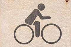 Bicycle symbol. A symbol, people are cycling. On background Royalty Free Stock Photos