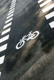 Bicycle symbol. On city street Royalty Free Stock Image