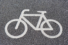 Bicycle symbol on asphalt Royalty Free Stock Images