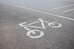 Bicycle symbol in bicycle lane on roadway Royalty Free Stock Image
