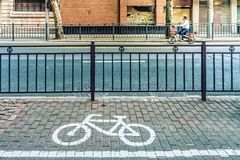 Bicycle symbol on bicycle parking lot at roadside Stock Photo