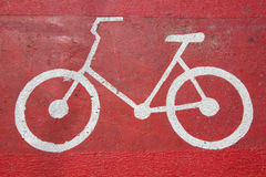 Bicycle symbol on bicycle way Stock Photos