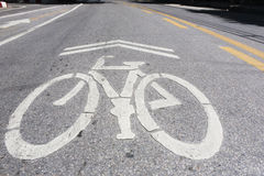 Bicycle symbol. On city street Royalty Free Stock Photography