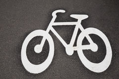 Bicycle Symbol on Cycle Lane with Cyclist in Helsinki Stock Photo
