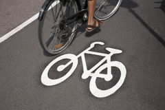 Bicycle Symbol on Cycle Lane with Cyclist in Helsinki Royalty Free Stock Images