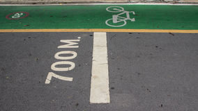 Bicycle symbol lane  on the road. The bike lane on the street, 700 meters distance Stock Photos
