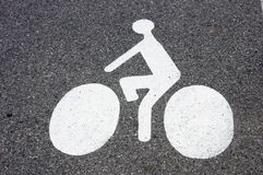 Bicycle symbol on the pavement. Symbol of cycling on the pavement to indicate a cycle track Royalty Free Stock Photo