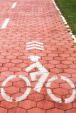 Bicycle symbol on a red bike path Royalty Free Stock Image