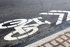Bicycle symbol on road in a street Royalty Free Stock Photos