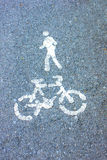 Bicycle symbol. Street gray background Stock Images