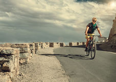 Bicycle tarveler ride on the road Royalty Free Stock Image