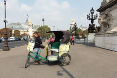 Bicycle taxi carries tourists for sightseeing. Royalty Free Stock Photo