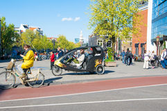 Bicycle taxi in the centre of Amsterdam, the Netherlands. Royalty Free Stock Images