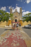 Bicycle taxi in front of Catholic cathedral of Izamal, Yucatan Peninsula, Mexico Royalty Free Stock Image