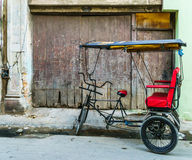 Bicycle Taxi Havana. A bicitaxi, aka bicycle taxi or pedicab, parked curbside in Havana, Cuba Stock Images