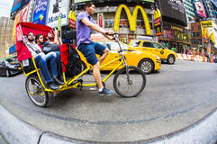 Bicycle taxi ride Times Square ,New York City Stock Image
