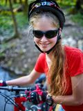 Bicycle teen with ladies bikes in summer park. Womens road bike for running. Royalty Free Stock Images