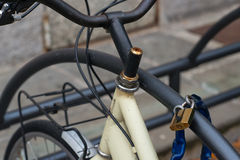 Bicycle tied by padlock Stock Photo