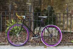 Bicycle tied to a fence Royalty Free Stock Photography