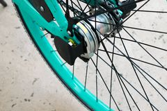 Tire spokes of Bright Color Turquoise Bicycle wheel. Bicycle tire gear, chain, spokes, of rear wheel tire. Macro photo of rear wheel details. Represents stock photo
