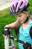 Bicycle tire pumping by child bicyclist . Kid with hand pump . Royalty Free Stock Images