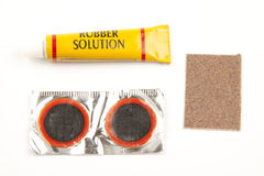 Bicycle tire repair kit. Items in a bicycle tire repair kit Stock Photos