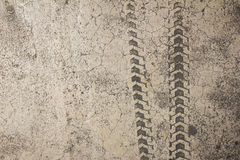 Bicycle tire track on cement floor Royalty Free Stock Photos