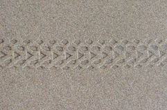 Bicycle tire tracks in wet sand Royalty Free Stock Photos