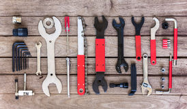 Bicycle tool. Bicycle professional tool set on wood plank background Stock Photo