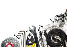 Bicycle tools and spares. Mountain bike tools and spares on white background Royalty Free Stock Photo