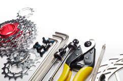 Bicycle tools and spares. Mountain bike tools and spares on white background Stock Photos