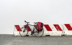 Bicycle on the top of Colle dell'Agnello (Alps). Bicycle with bags on the top of Colle dell'Agnello (Italy-France, Alps Royalty Free Stock Photography