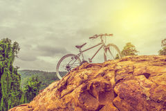 bicycle on the top of rock mountain Stock Image