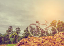 bicycle on the top of rock mountain Royalty Free Stock Photo