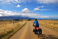 Bicycle Touring in New Zealand. A man travelling by bicycle on the South Island of New Zealand Stock Image