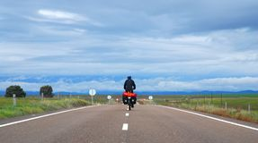 Bicycle Touring In Spain. A man riding his bicycle through the Spanish countryside in the Extremadura region, just north of Andalucia royalty free stock photo